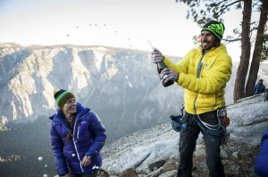 Kevin Jorgeson pops a bottle of sparkling wine to celebrate his historic free-climb ascent of El Capitan's Dawn Wall, in Yosemite National Park, Calif.