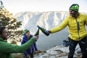 Kevin Jorgeson and Tommy Caldwell, left, toast upon completing their historic free-climb ascent of El Capitan's Dawn Wall, in Yosemite National Park, Calif.