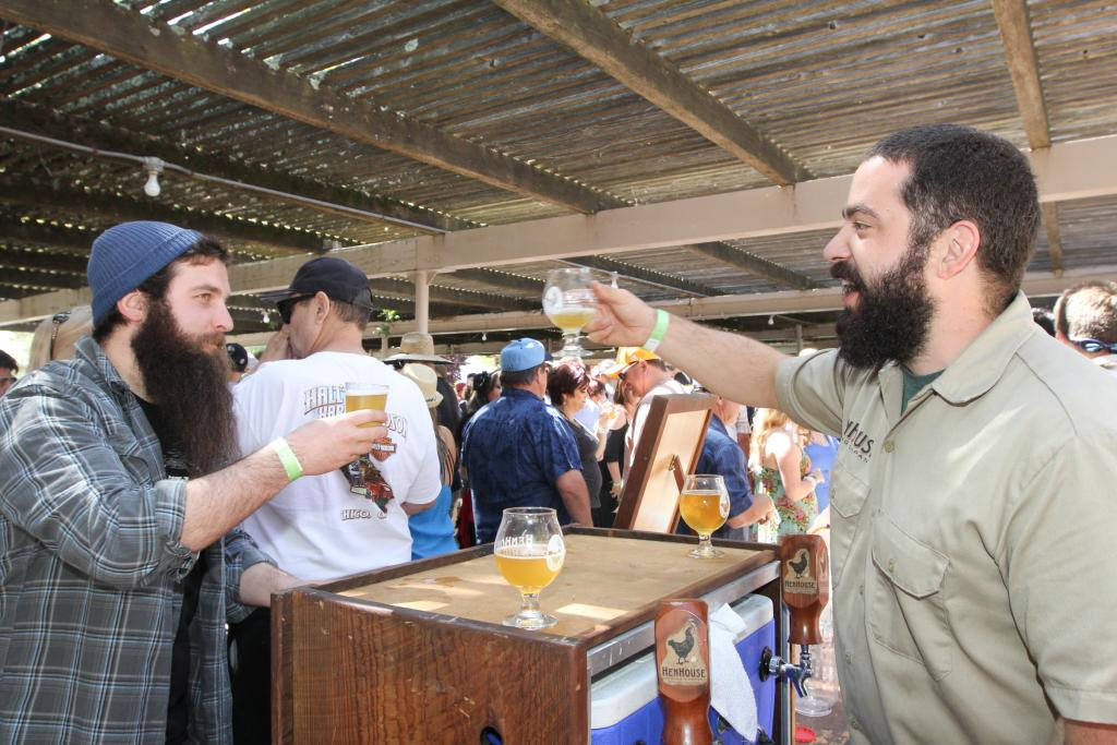 Collin McDonnell of HenHouse Brewing cheers Zac Greenwood at the 18th Annual Great Chili Cook-off, Salsa & Beer Tasting that was held at the Petaluma Fair Grounds on Saturday May 9, 2015. (photo by Victoria Webb)