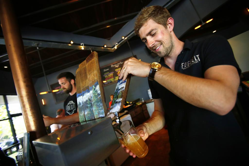 Fraser Ross pours a beer for the Friday crowd at Fogbelt Brewing Company. (Conner Jay)