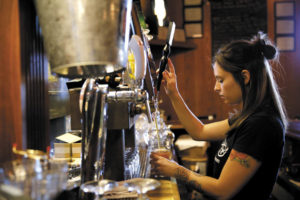 Bartender Cheryl Avery pours a pint of beer at Taps Restaurant and Tasting Room in Petaluma. (photo by Beth Schlanker)