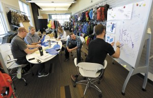 A design team discusses new ways to engineer water reservoirs at the offices of CamelBak in Petaluma.