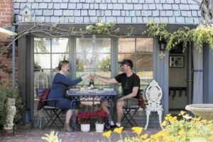 Shanon Johnson and her husband, Eric, of Seattle, celebrate their wedding anniversary in a cottage behind the home of Sandy and Bud Metzger. The cottage, located in a historic Santa Rosa neighborhood, is offered through Airbnb. (photo by Jeremy Portje)