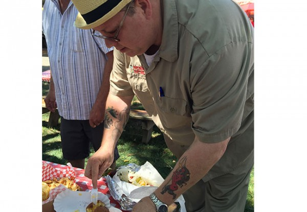Scrambler Robb tasting fried cheese at the Sonoma County Fair 2015