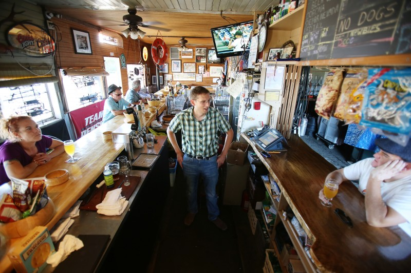 Bartender and owner Ernie Altenreuther, center, talks with regulars at Ernie's Tin Bar in Petaluma on Wednesday, July 31, 2013. (Conner Jay/The