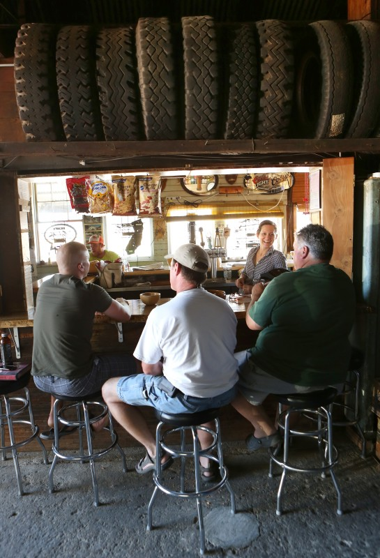 An overflow crowd sits in garage in the back of Ernie's Tin Bar in Petaluma.(Conner Jay)