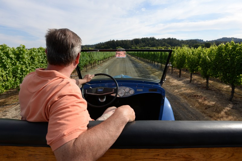 The 1932 Ford owned by Bengt Akerlind and being driven through his vineyards at West Wines in Healdsburg, California. July 1, 2015. (Photo: Erik Castro