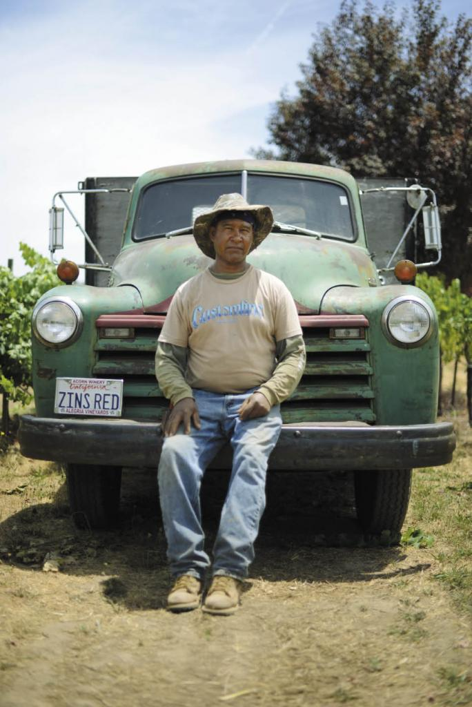 Vineyard worker Manuel Apolinar poses on the 1950 Chevy owned by Bill Nachbauer of Acorn Winery in Healdsburg.