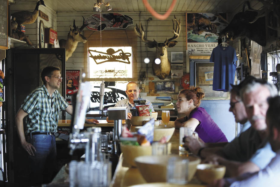 Owner Ernie Altenreuther, left, talks with regulars at the bar. (Photo by Conner Jay)