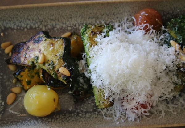 Grilled squash with pickled tomatoes, a vegetarian dish