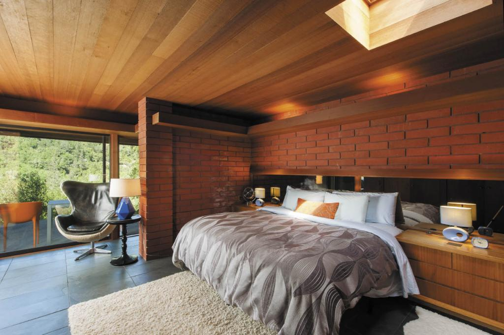 An Eames chair offers a perfect reading spot in the master bedroom.