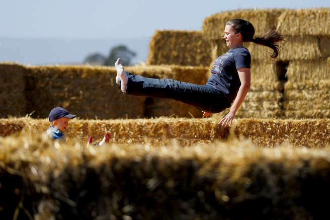 Amanda Clark and her son Landon, 2, have fun together on the jump pillow at the Santa Rosa Pumpkin Patch in Santa Rosa, on Monday, Oct. 5, 2015. (Beth Schlanker / The Press Democrat)