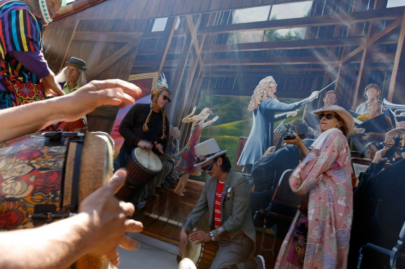 Musicians play in a drum circle at the Occidental Center for the Arts after the Fool's Parade in Occidental, California, on Saturday, April 2, 2016. (Alvin Jornada