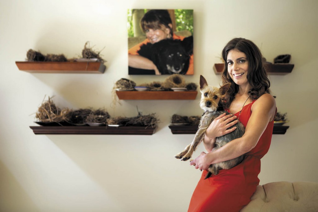 Daniela Tempesta holds Vico, a rescue dog that belonged to her mother. The photo on the wall behind them is of Bonnie Lynn, a devoted animal lover, with one of her favorite rescue pooches. Boncora Biscotti still donates part of the proceeds from cookie sales to Pets Lifeline in Sonoma.