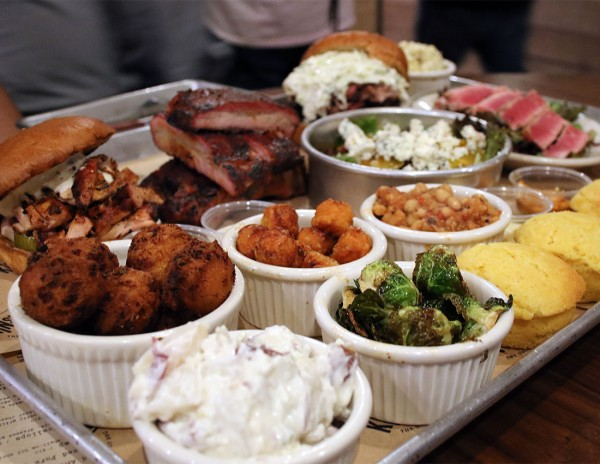 Ribs, hush puppies, cornbread and Brussels sprouts at KINSmoke, one of the Best Restaurant Dishes of 2015