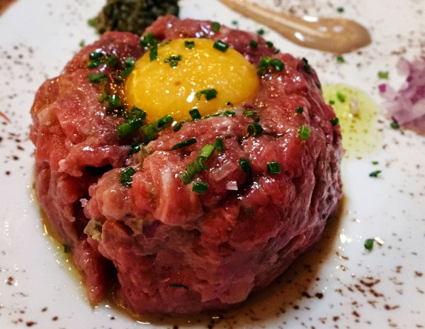 Beef tartare with quail egg at Ca'Momi Osteria in Napa. Heather Irwin/PD