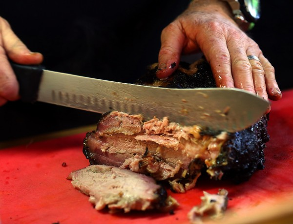 Slicing beef brisket at the Cochon Volant BBQ Smoke House in Sonoma. (JOHN BURGESS / The Press Democrat)