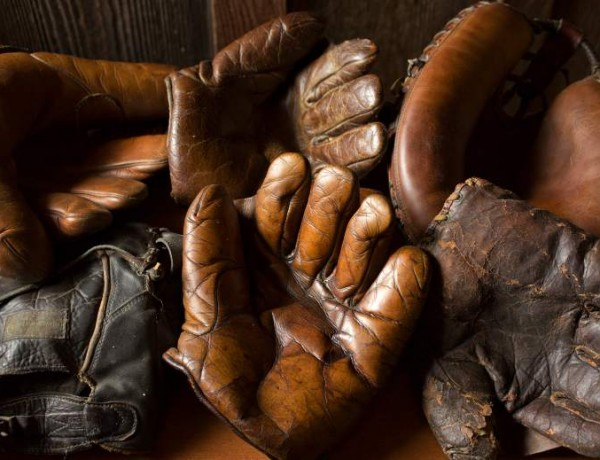 A collection of gloves from a century ago. Fran Fleet, 'The Glove Lady,' has been repairing baseball gloves out of her tiny Cotati shop for over 40 years. (JOHN BURGESS / The Press Democrat)