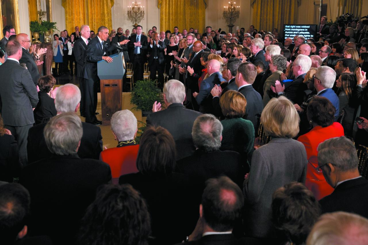 Thompson is part of the crowd that stands and applauds as President Barack Obama speaks in the East Room of the White House on Jan. 5, 2016. He outlined steps his administration is taking to reduce gun violence. Among those onstage are people whose lives have been impacted by gun violence. (Jacquelyn Martin/Associated Press)