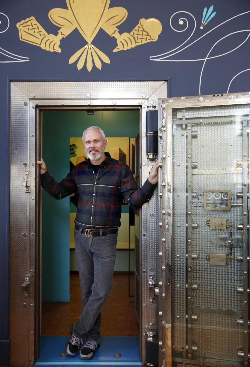 Bob Pullum, the owner of Guerneville Bank Club, stands next to the old vault inside the building. (BETH SCHLANKER/ The Press Democrat)