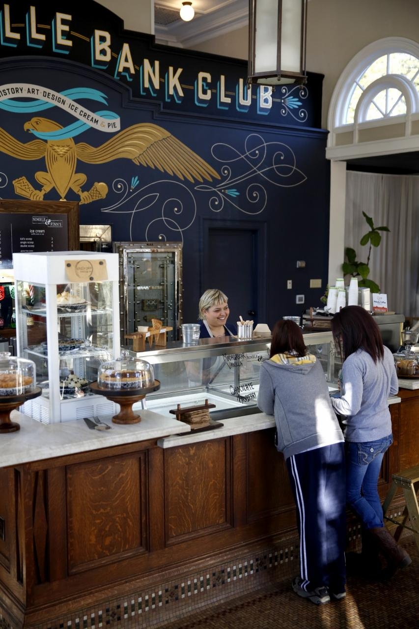 Customers buy ice cream from Chile Pies Baking Company inside the Guerneville Bank Club in Guerneville. (BETH SCHLANKER/ The Press Democrat) Beth Schlanker