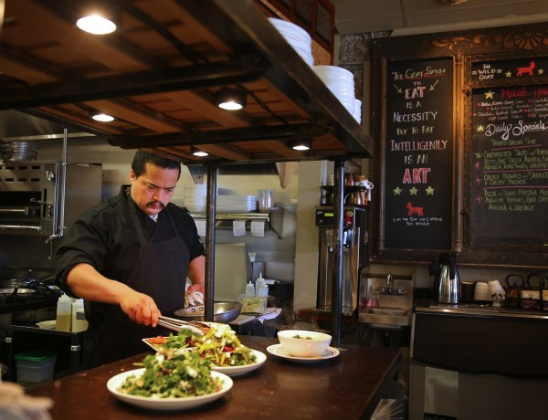 Chef Victor Escobar puts the finishing touches on a dish before sending it out to a customer at Wild Goat Bistro in Petaluma, on Wednesday, March 2, 2016. (Christopher Chung/ The Press Democrat)