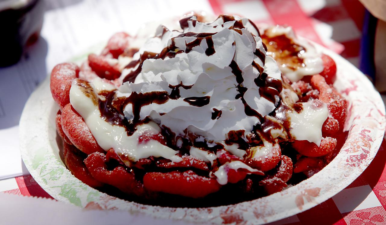 Once a year, funnel cakes at the Sonoma County Fair are available. The lines for these deep fried treats can sometimes be longer than the ride lines, but just one bite is powdered-sugar heaven. The 2016 fair will be from July 22 to Aug. 7. (Kent Porter / Press Democrat)