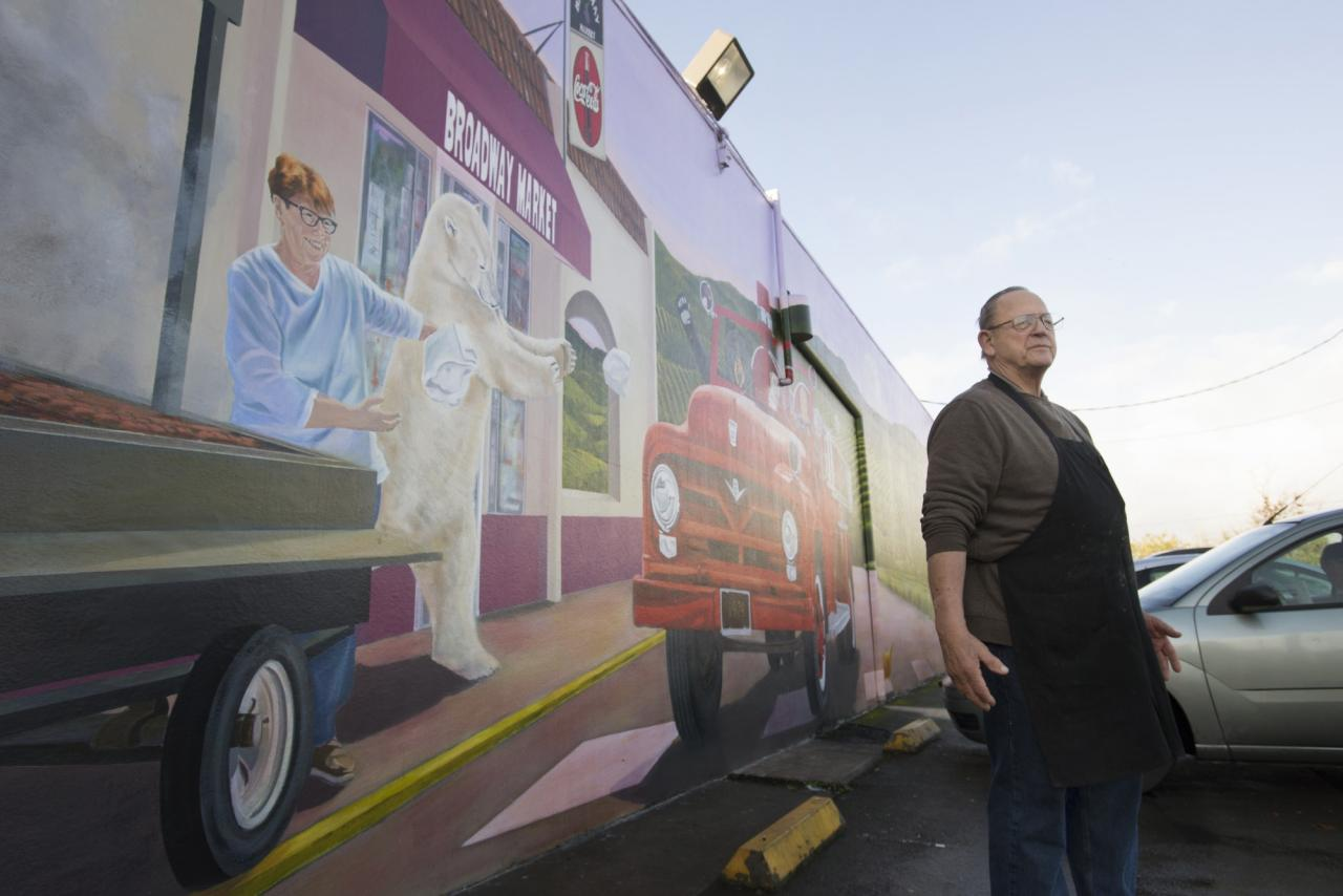 Longtime butcher Tom Geney, 74, next to a mural which covers an entire wall of Broadway Market in Sonoma, California. Geney who has been a butcher for 49 years and has spent about the last 12 years at the Broadway Market meat counter. January 13, 2016. (Photo: Erik Castro/for The Press Democrat)