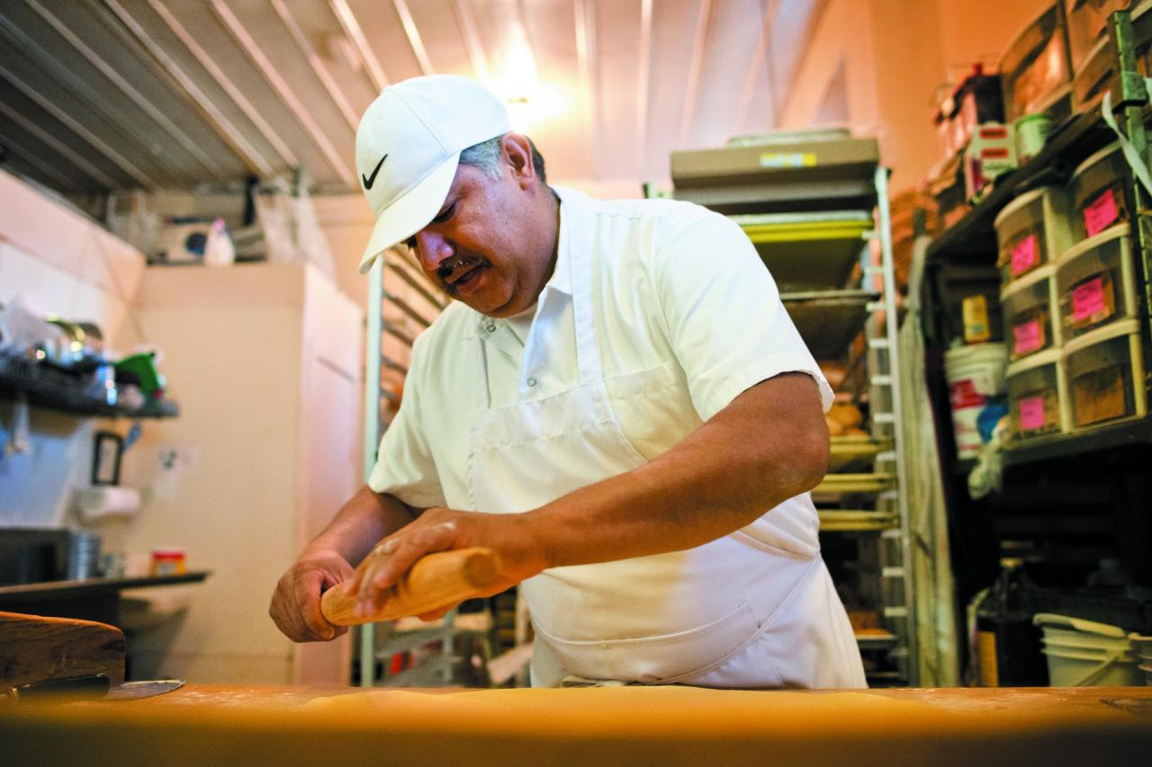 Roberto Perdomo rolls out dough to make fruit-filled empanadas at his Cloverdale bakery, Panaderia El Palomo, which he and his wife, Adriana Lara, opened in 2005. (Photo / Alvin Jornada)