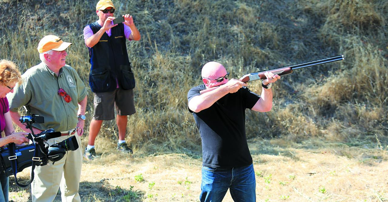"Mike Thompson, left, watches his friend retired astronaut Mark Kelly shoot sporting clays at the Napa Police practice range in 2013. Kelly's wife, then-Congresswoman Gabrielle ""Gabby"" Giffords, survived an assassin's shooting attack in 2011 but suffered severe brain damage that ended her political career. (Kent Porter / Press Democrat)"
