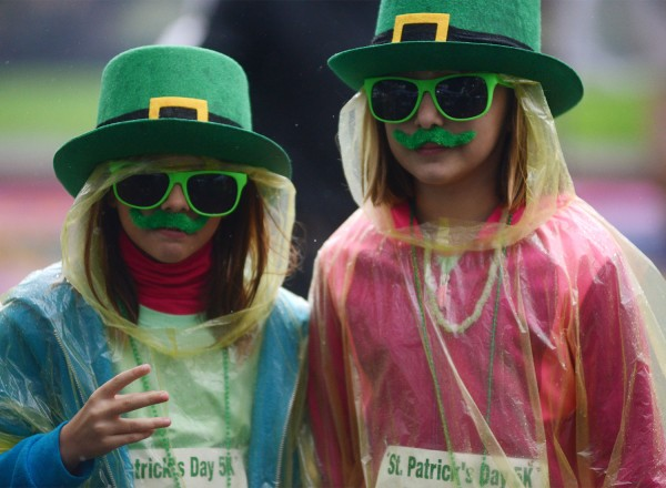 Leila Paine, 9, left and Bree Tyler, 9, arriving in festive attire for the St. Patrick's Day 5K run held at Juilliard Park in downtown Santa Rosa Sunday. Proceeds from the race benefit the Santa Rosa Recreation & Parks Scholarship Fund. March 13, 2016. (Photo: Erik Castro/for The Press Democrat)