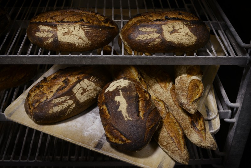 A selection of fresh baked bread by Eli Colvin, owner of Revolution Bread, which he baked during his last day working at The Model Bakery in Napa. February 28, 2015 (Photo: Erik Castro/for The Press Democrat)