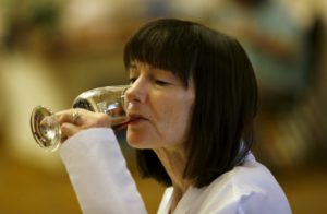 Judge Ellen Landis tastes a glass of wine during the North Coast Wine Challenge at the Hilton Sonoma Wine Country Hotel in Santa Rosa, on Tuesday, April 12, 2016. (BETH SCHLANKER/ The Press Democrat)
