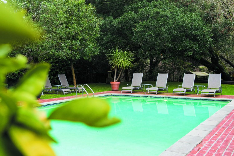 The pool awaits in a serene setting.