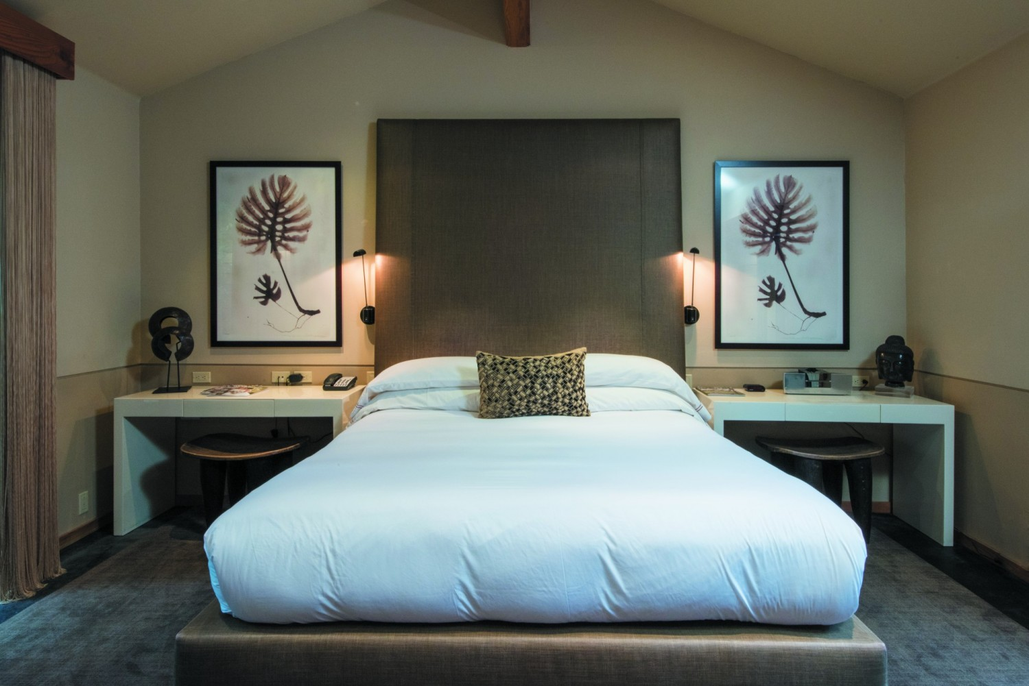 Crisp white linens and oversized pillows spell comfort for guests, whose suites are decorated with Asian woven baskets and leaf prints.