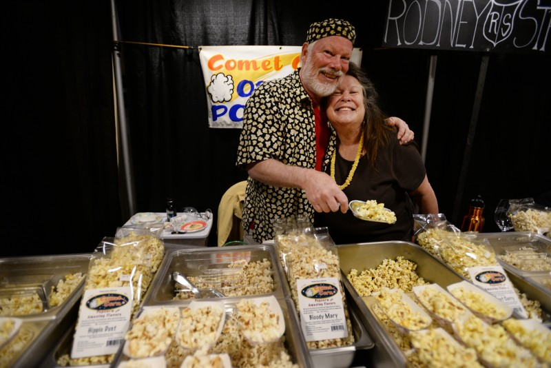 Jeff Phillips, left, and Sherry Soleski serving up their Comet Corn popcorn during Pick of the Vine wine tasting and auction gala held at the Luther Burbank Center for the Arts in Santa Rosa, Saturday. The event benefits Senior Advocacy Services. April 30, 2016. (Photo: Erik Castro/for The Press Democrat)