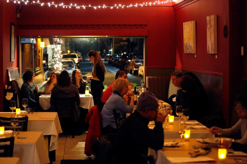 Guests are seated for dinner at Bistro 29 in Santa Rosa. (Alvin Jornada / The Press Democrat)