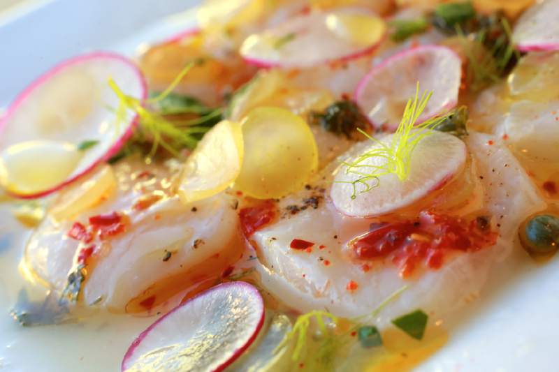 Cured scallops with grapes, radish, lime and Calabrian chiles at Hazel in Occidental. ( John Burgess / The Press Democrat)