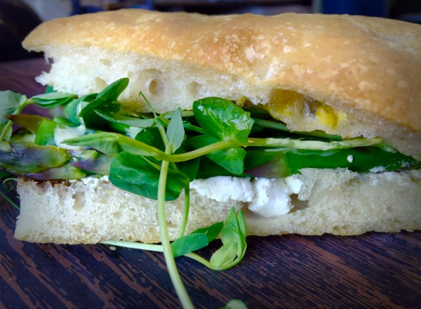 Focaccia with pea shoots, asparagus and cream cheese at The Pharmacy. (Heather Irwin)