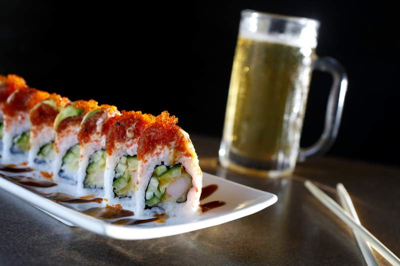 A Red Dragon Roll and a Sapporo beer at O! Sushi in Santa Rosa, on Monday, June 8, 2015. (Beth Schlanker / The Press Democrat)