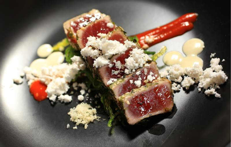 Ahi Tataki with wakami seaweed salad, pureed kim chi, soy-seaweed emulsion and dried sesame seed powder by chef Dustin Valette at Valette Healdsburg. (John Burgess / The Press Democrat)