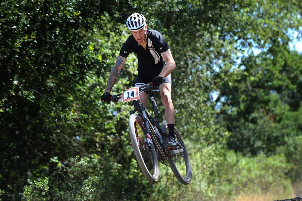 Shane Bresnyan catching some air on Canyon Trail in Annadel Park, Santa Rosa. ( Erik Castro/ The Press Democrat)