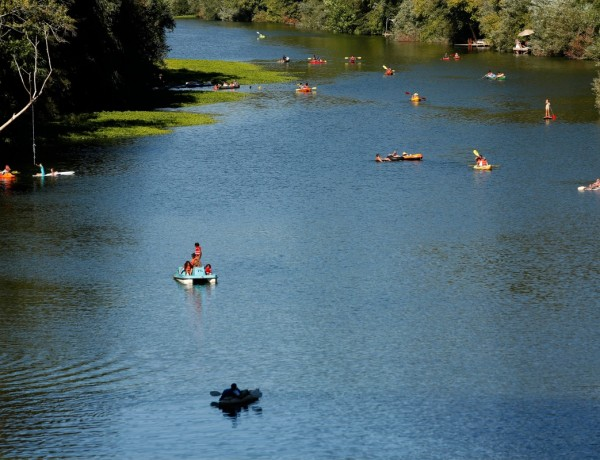 People float down the Russian River by various methods of transportation towards Johnson's Beach in Guerneville. (Alvin Jornada / The Press Democrat)