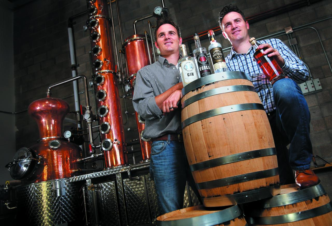 Twin brothers Chris, left, and Brandon Matthies own and operate Sonoma Brothers Distilling, in Windsor. The brothers produce gin, vodka and whiskey in their handmade Arnold Holstein copper pot still. (Photo by Christopher Chung)