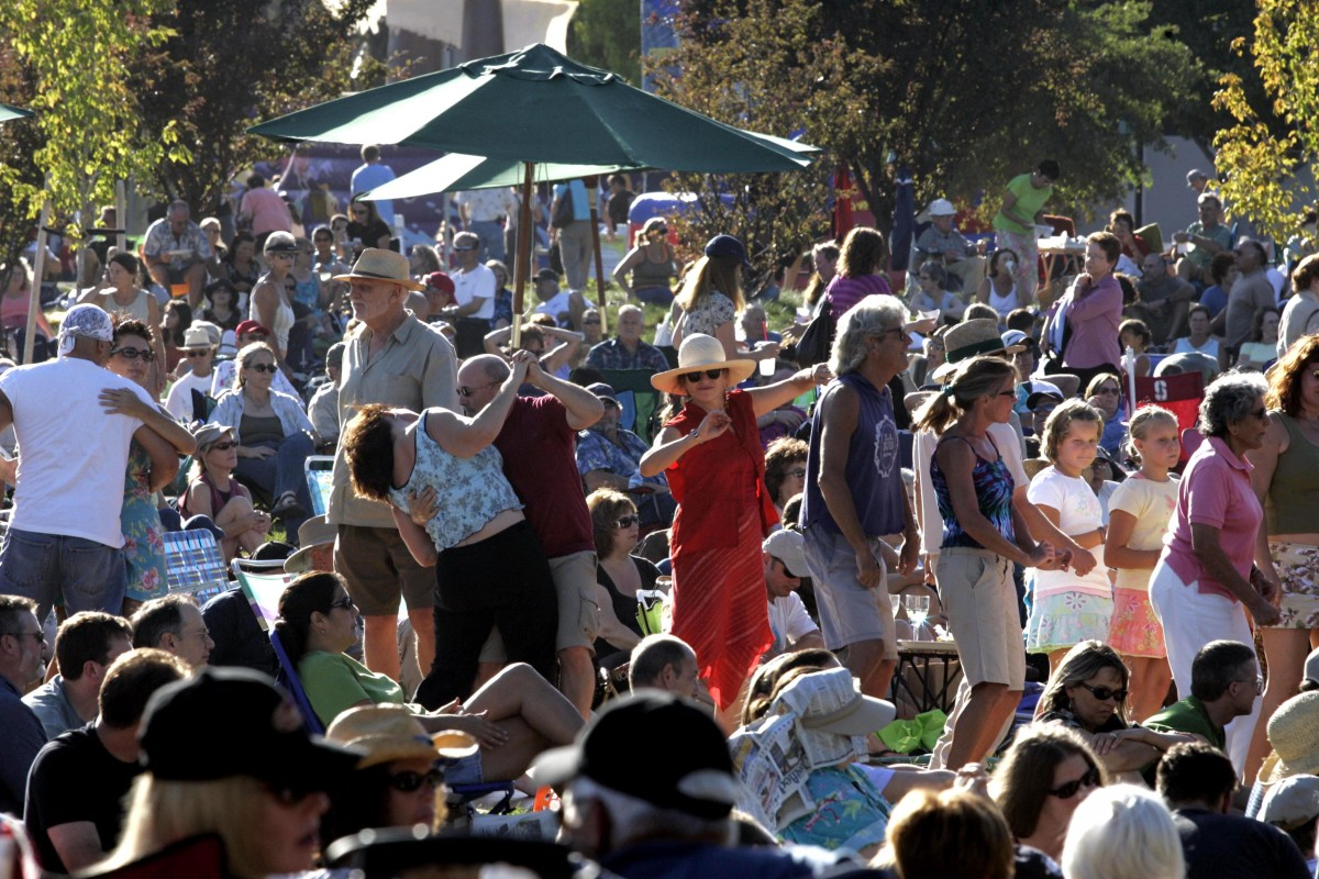 Dancing at Summer Nights on the Green in Windsor. (Crista Jeremiason / The Press Democrat)