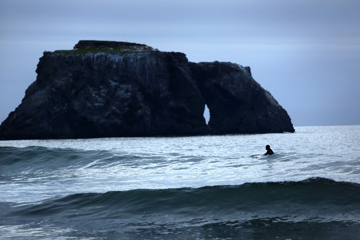 Watch natural pieces of rock art, and surfers, by Goat Rock Beach.