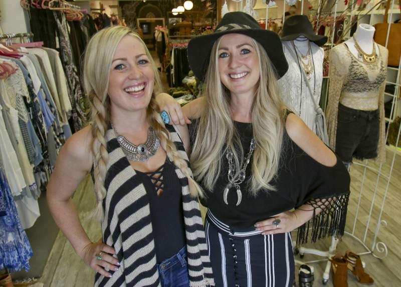 Cristina Wilson Hudin, left, and Michelle Wilson Bien twin sisters and native Petalumans founded Ooh La Loft, a Petaluma-based clothing store (Scott Mancheters / Argus-Courier Staff)