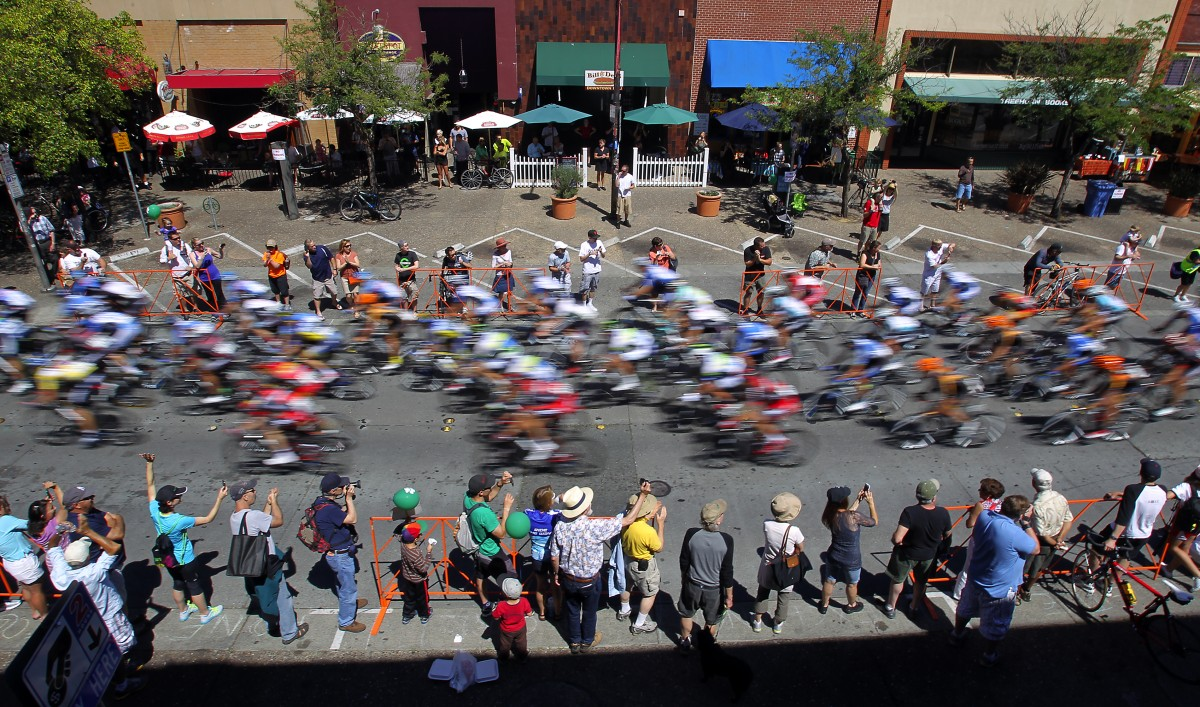 Riders speed down 4th St. in downtown Santa Rosa on the final lap of the final day of the 2013 Amgen Tour of California (John Burgess/The Press Democrat)