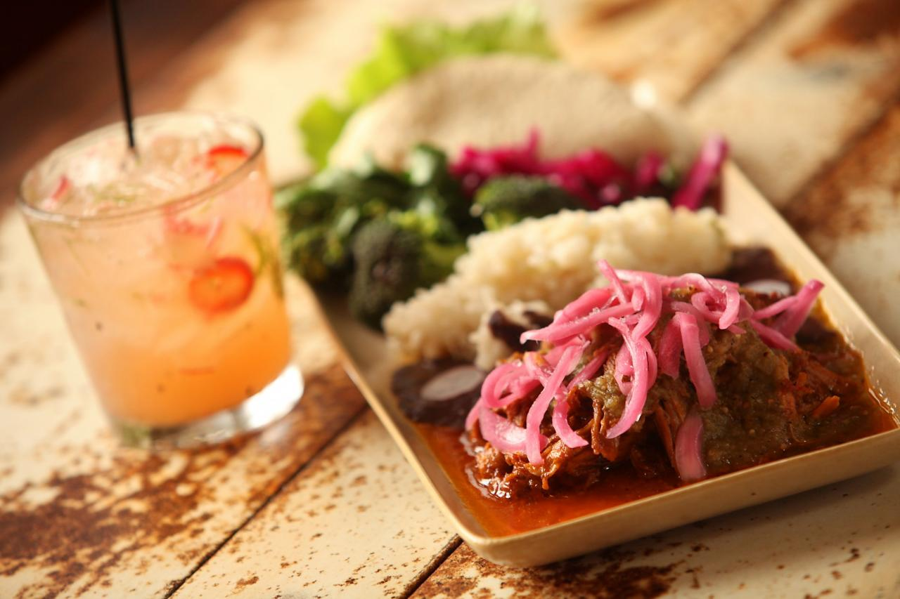 Conchinita Pibil, by Mateo Granados, at Mateo's Cocina Latina in Healdsburg, served with a rhubarb inspired margarita. The dish features slow-roasted pork marinated in annatto seed with homemade tortilla and cinnamon-cured red onions. (Christopher Chung / The Press Democrat)