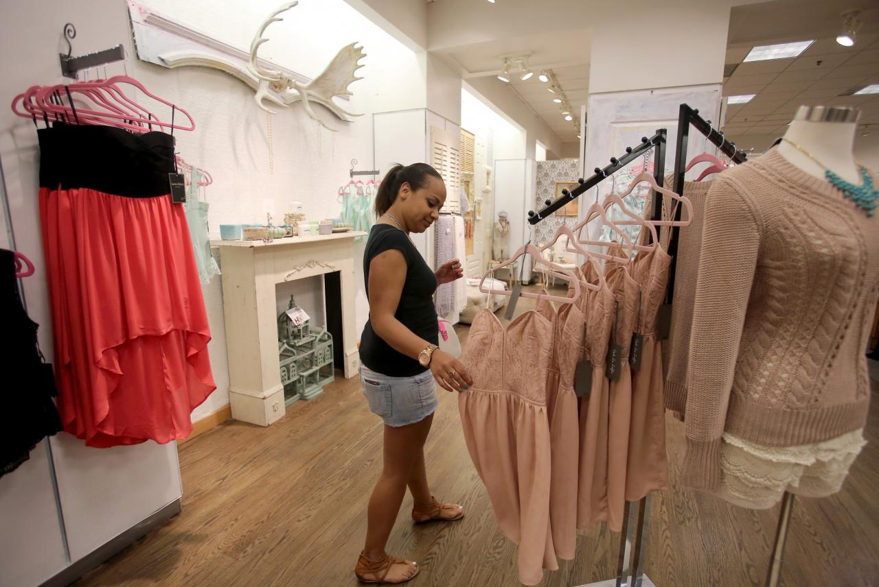 Ruthie Brown checks out the clothing and accessories at Ooh La Loft that opened at Santa Rosa Plaza in March 2013. (Crista Jeremiason / The Press Democrat)